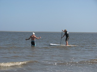 Johnny Laing teaching SUP at East Beach on St Simons