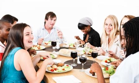 friends around dinner table
