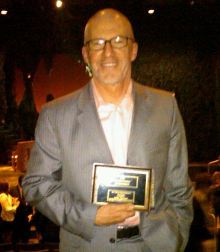 Tom Dugan with award