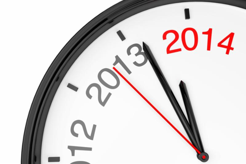 The year 2014 is approaching. 2014 sign with a clock on a white background