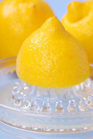 lemons in glass juicer