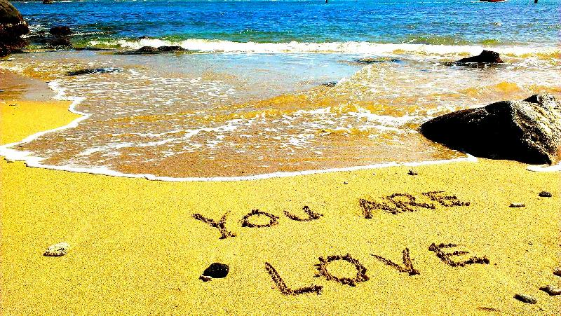 You Are Love written in the sand