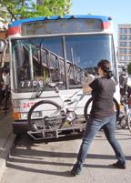 Bicyclist using bike rack
