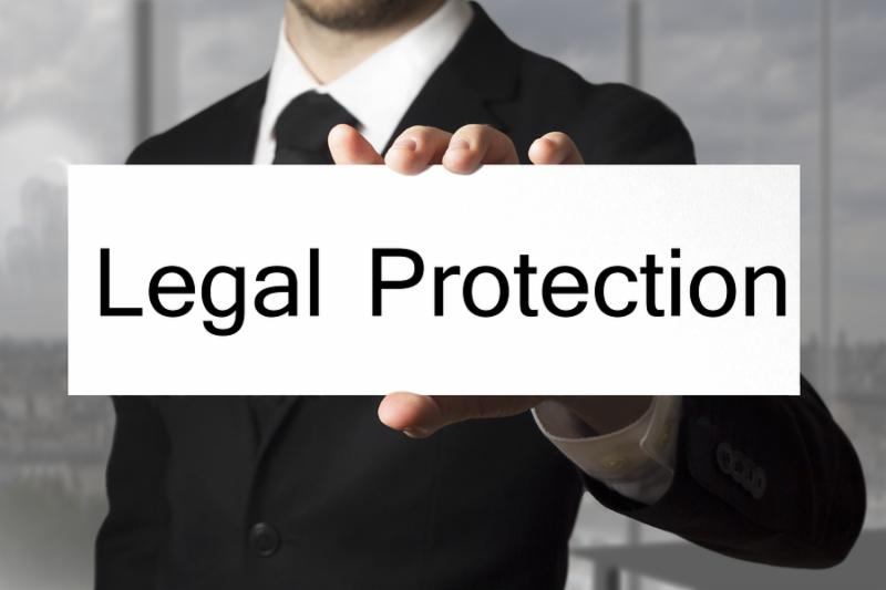 businessman in black suit office showing sign legal protection