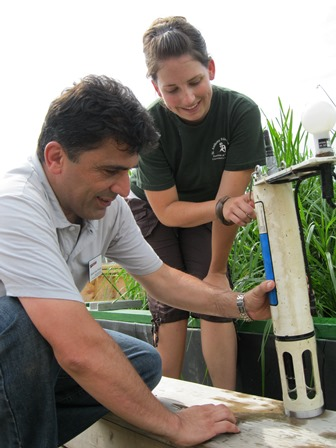 Child and adult building a tool for measuring water clarity