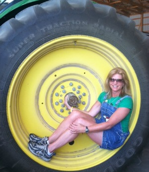 Michele Melius poses in a tractor tire.