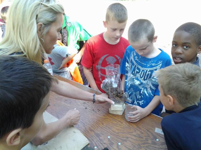 students do an experiment with soil erosion