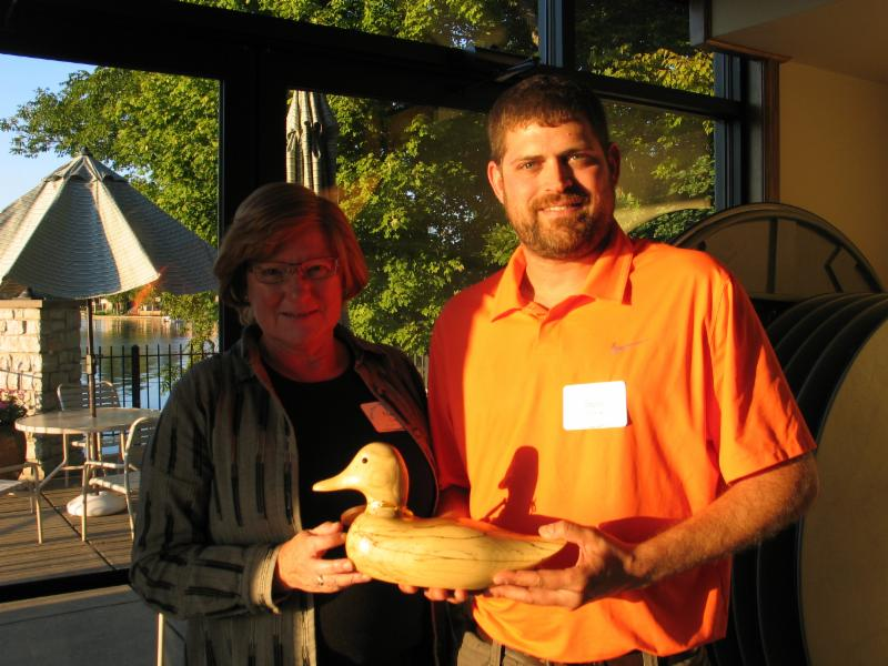 Nanci Good,  White River Alliance board member, presented the award to Steve Schmidt of the Madison County SCWD.