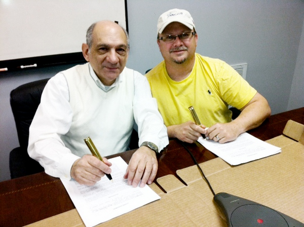 MICOR Defense Owner Mike Heath and Leader 50 Designer Charles St. George Sign Agreement.
