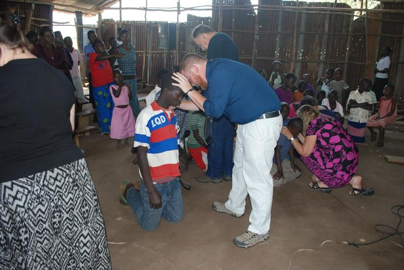 Scott Praying at Royal Palace Church, Uganda