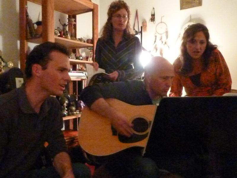 Teal playing guitar