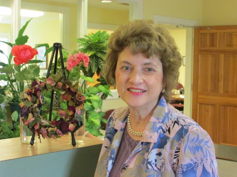 Margaret Melancon with winning flower specimens
