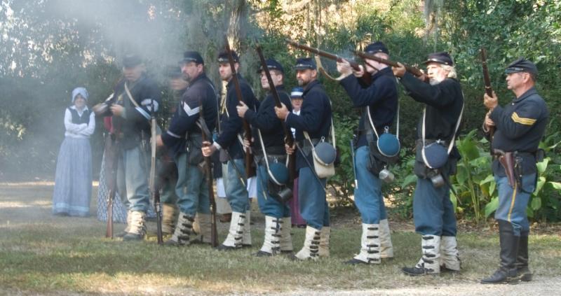 Soldiers firing at Shadows Civil War Encampment