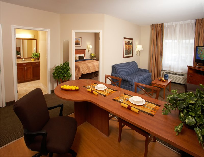 Relax in spacious guest suites with fully equipped kitchen and complimentary Wi-Fi, business center, laundry facilities, gym and cupboard with food and sundry items.