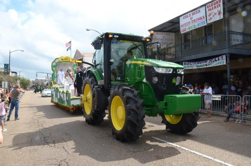 Tractor pulling float at Sugar Cane Festival parade on Main Street