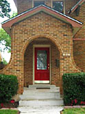 Stately, curved brick entrance portico