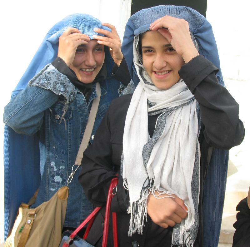 Raghia and Gulnaz burqa up to go home