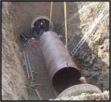 Pipe being put in