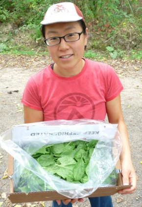 Kim w/ box of baby spinach