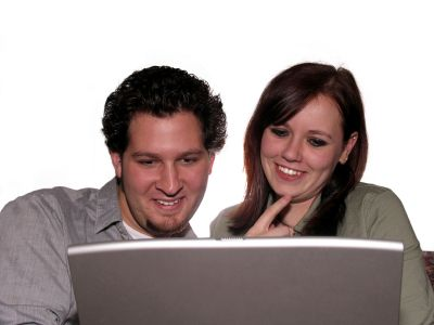 happy couple at computer