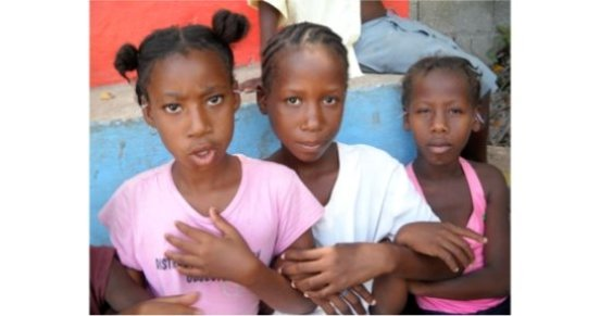Haitian girls with ear  needles during  treatment