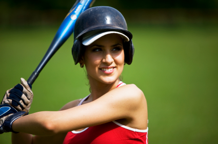 Woman up to bat looking confident