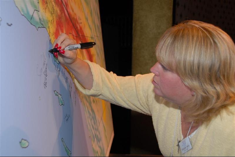 Kelly signing the GIANT MAP OF CALIFORNIA for Shake Out