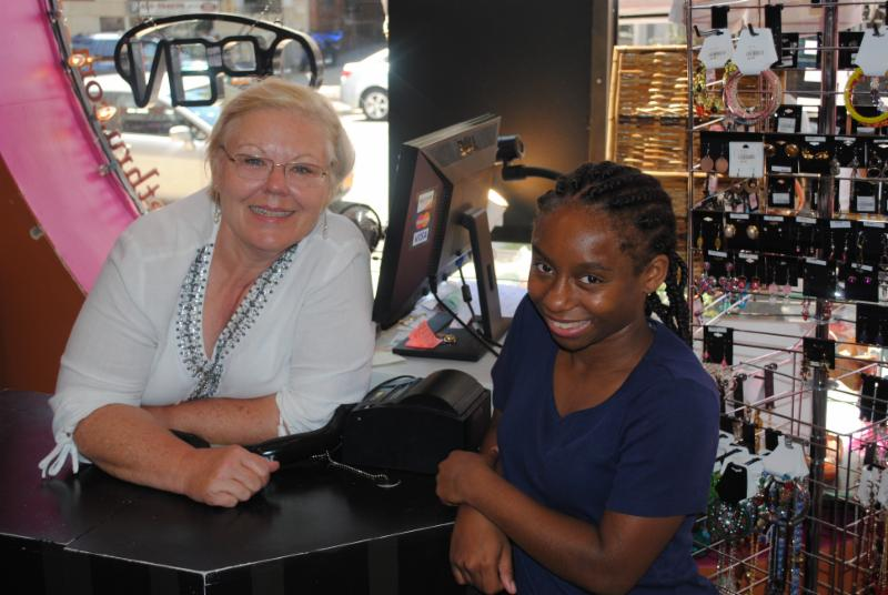 Close up of store owner_ Pamela Corkran_ and PROMISE participant_ Nia_ during a summer workplace experience