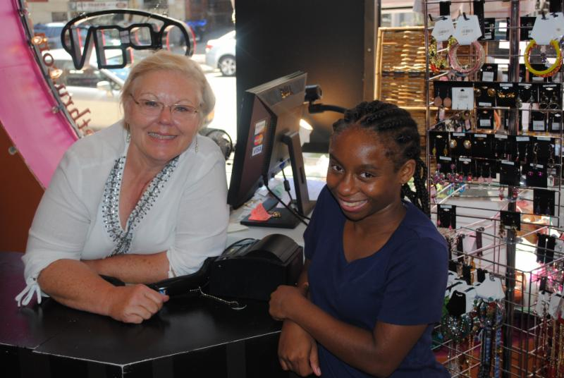 Pamela Corkran and Nia pose at the consignment store
