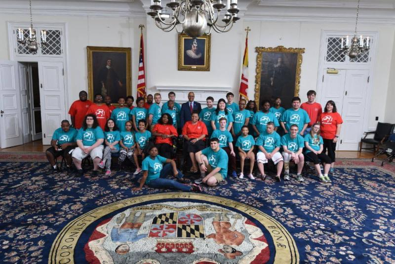 Group photo in Maryland State House reception room with Lieutenant Governor along with Youth Leadership Forum students and leaders