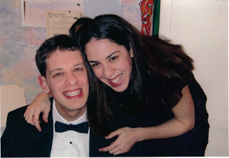 David in a tuxedo with his sister_ Sarah_ hugging him from above