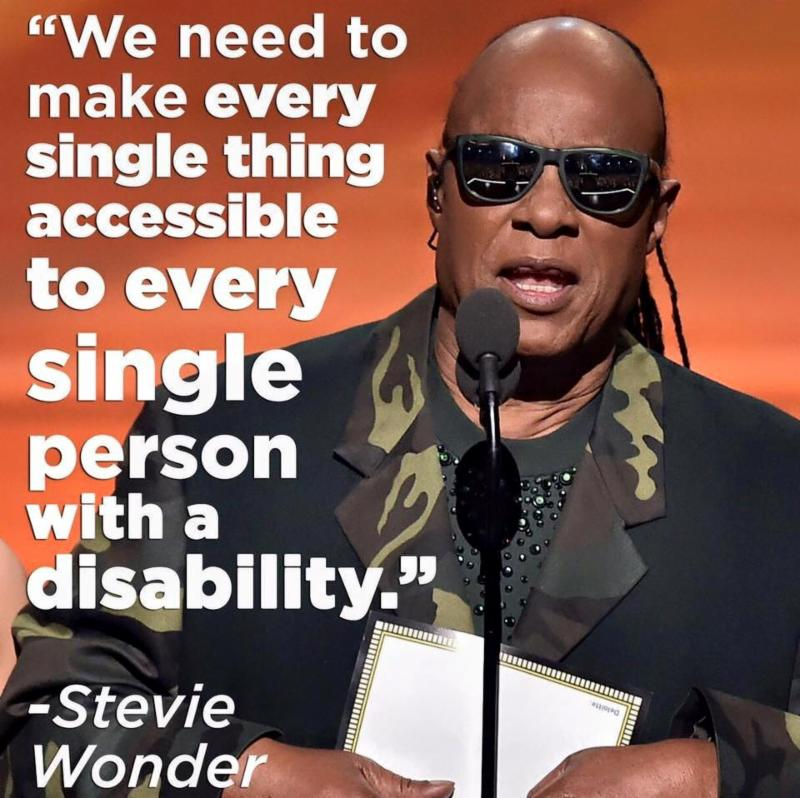 Image of Stevie Wonder at Grammy Awards with his words in white_ _We need to make every single thing accessible to every single person with a disability_