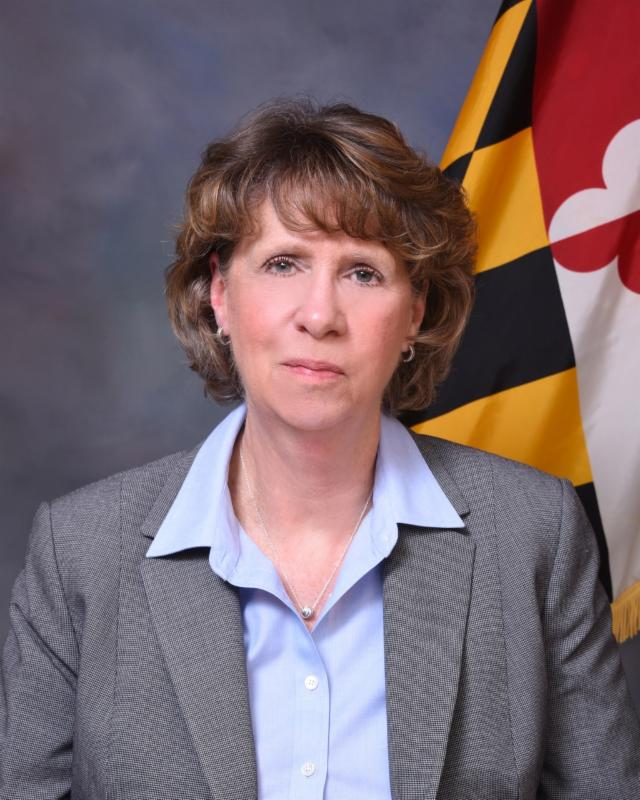Close up of Secretary Beatty with Maryland flag in background