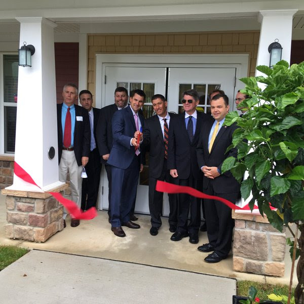 Partners in the 811 program cutting red ribbon at housing opening