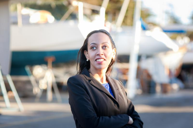 Image of Haben Girma in black business suit with blurry background outside
