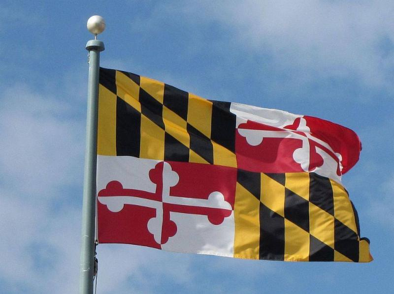 Image of Maryland State flag against blue sky