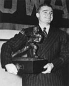 Nile Kinnick with Heisman Adel IA