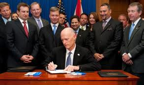 Gov Scott Signing