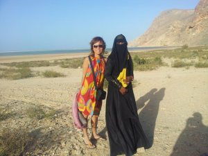 Mai in Socotra with a covered woman