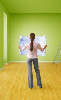 Woman holding blueprint