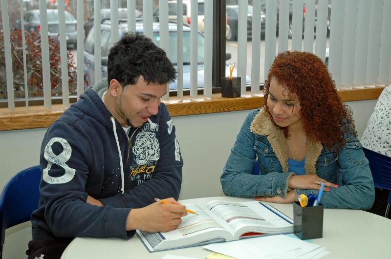 LSSC Math Tutor Hector Melendez helps a student with homework