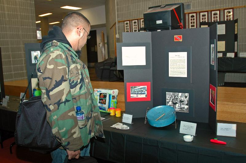 Student viewing the Black Inventions Exhibit