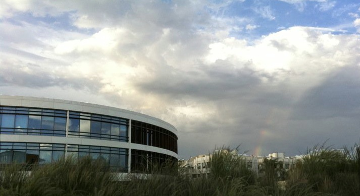 Library with rainbow in background