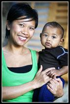 Mom_Baby_3quarters_vertical_green_smiling girlie and deisel