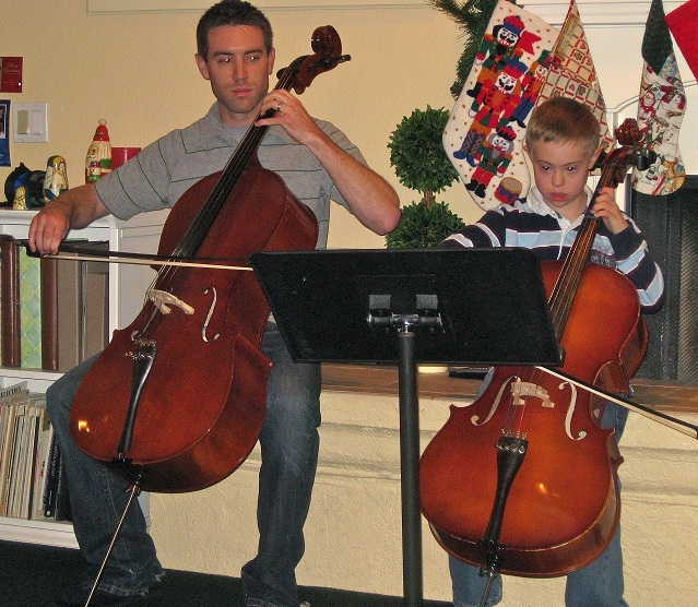 Parker playing cello