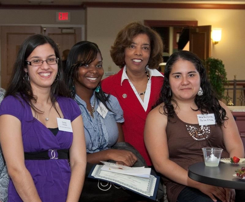 President Reid with students at a scholarship reception.