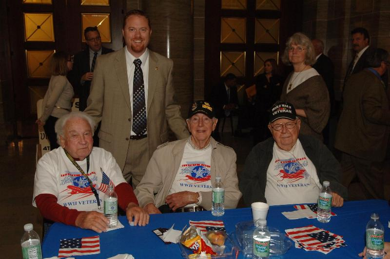 A picture of Rep. Holsman with a group of WWII Veterans.