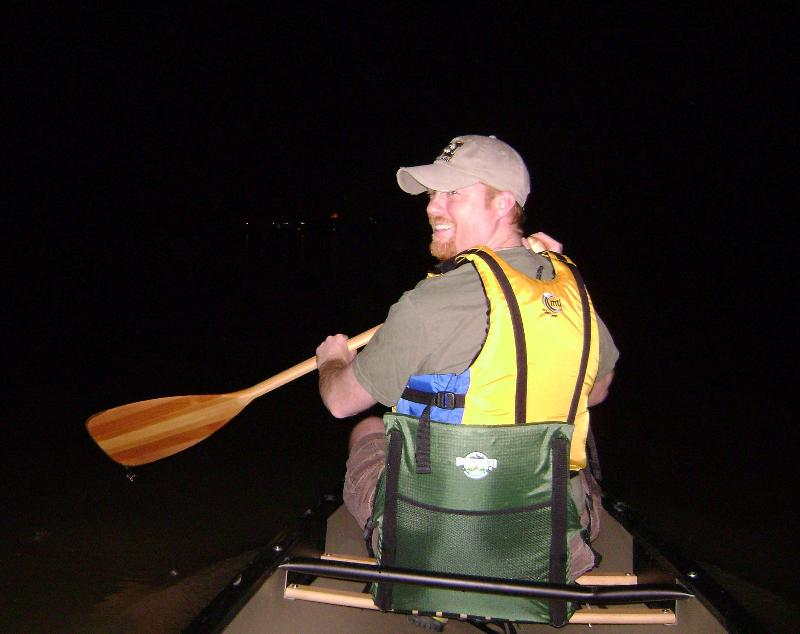 Rep. Jason Holsman in a canoe after sundown on the Missouri River.