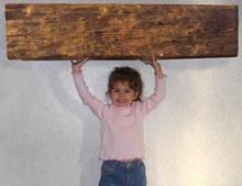 Girl holding beam