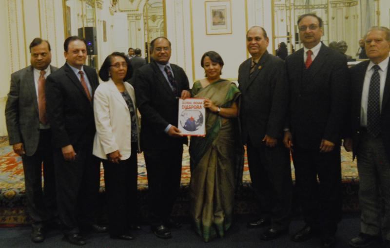 GOPIO Founder President Dr. Thomas Abraham presenting a bookGlobal Indian Disapora - 'GOPIO Making an Impact to Ambassador Riva Ganguly Das